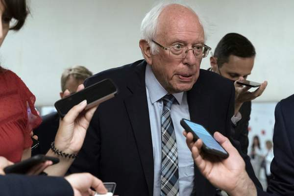 Sen. Bernie Sanders, I-Vt., talks to reporters as he walks to the senate chamber ahead of a test vote scheduled by Democratic Leader Chuck Schumer of New York on the bipartisan infrastructure deal senators brokered with President Joe Biden, on Capitol Hill, in Washington, Wednesday, July 21, 2021. (AP Photo/Jose Luis Magana)