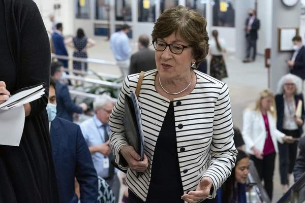 Sen. Susan Collins, R-Maine, talks to reporters as she walks to the Senate chamber ahead of a test vote scheduled by Democratic Leader Chuck Schumer of New York on the bipartisan infrastructure deal senators brokered with President Joe Biden, on Capitol Hill, in Washington, Wednesday, July 21, 2021. (AP Photo/Jose Luis Magana)