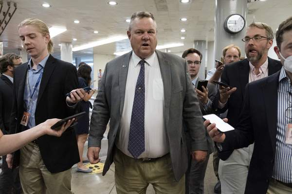 Sen. Jon Tester, D-Mont., talks to reporters as he walks to the Senate chamber ahead of a test vote scheduled by Democratic Leader Chuck Schumer of New York on the bipartisan infrastructure deal senators brokered with President Joe Biden, on Capitol Hill, in Washington, Wednesday, July 21, 2021. (AP Photo/Jose Luis Magana)