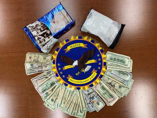 This undated photo provided by the Maine Drug Enforcement Agency shows a marble cake which contained about 2 pounds of cocaine, and cash, seized from a vehicle in Gardiner, Maine. (Maine Drug Enforcement Agency via AP)