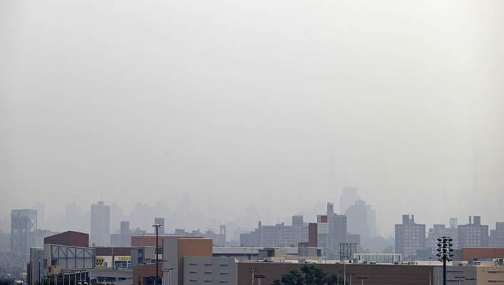Smoke blocks the view looking toward Manhattan from Yankee Stadium before the Philadelphia Phillies played the New York Yankees in a baseball game Tuesday, July 20, 2021, in New York. (AP Photo/Adam Hunger)