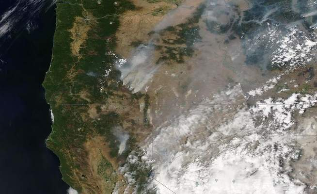 This satellite image provided by Satellite image ©2021 Maxar Technologies shows overview of wildfires from Oregon, Idaho, and Northern California on Sunday, July 18, 2021. (Satellite image ©2021 Maxar Technologies via AP)