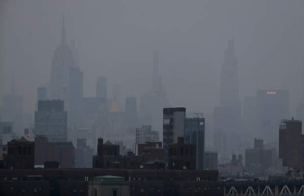 A thick haze hangs over Manhattan, Tuesday, July 20, 2021, in New York. (AP Photo/Julie Jacobson)