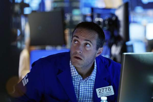 Specialist Michael Gagliano works at his post on the trading floor of the New York Stock Exchange, Tuesday, July 20, 2021. (AP Photo/Richard Drew)
