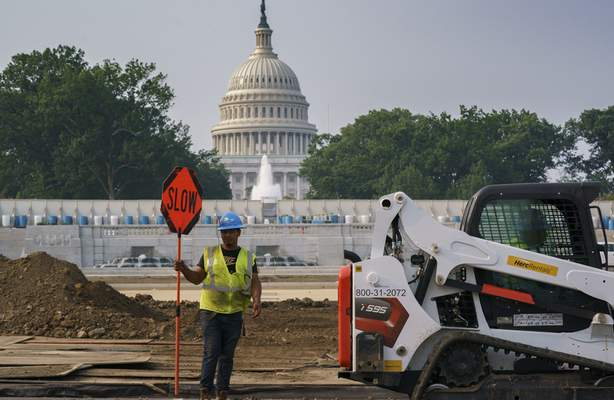 Associated Press Workers repair a park Wednesday near the Capitol in Washington as senators struggle to reach a compromise over how to pay for nearly $1 trillion in public works spending.