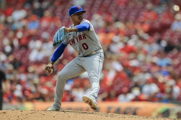 Associated Press New York's Marcus Stroman delivers to home against the Reds on Wednesday in Cincinnati.