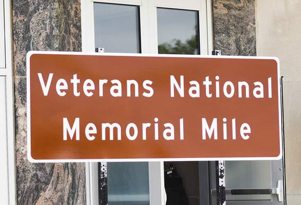 Katie Fyfe | The Journal Gazette  The unveiling of the Veterans Memorial Mile takes place at the Allen County Memorial Coliseum Veterans Plaza on Wednesday.