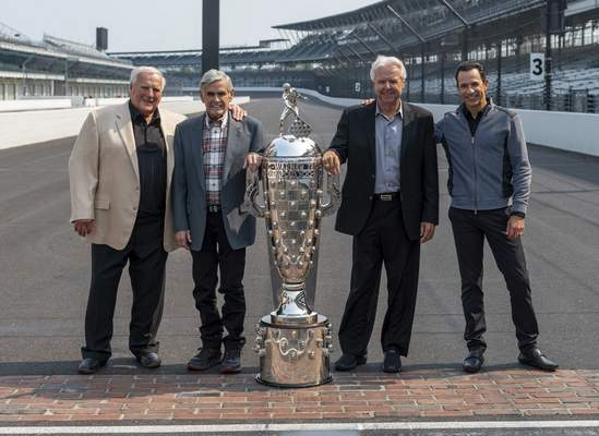 Associated Press Winner of this year's Indianapolis 500 auto race, Helio Castroneves, right, gathered with other four-time winners, from left, A.J. Foyt, Al Unser and Rick Mears at the Indianapolis Motor Speedway in Indianapolis on Tuesday.