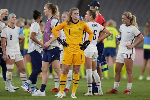 United States' goalkeeper Alyssa Naeher, center, reacts at the end of the team's match against Sweden on Wednesday in Tokyo.