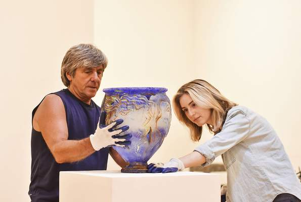 """Katie Fyfe   The Journal Gazette Charles Shepard and Jenna Gilley set up a piece by Charles Miner called """"Mary's Ladies"""" on Wednesday as part of Fort Wayne Museum of Art's upcoming exhibit, """"A Love of Light: The Fendel/Rosenbach Collection,"""" opening Saturday."""