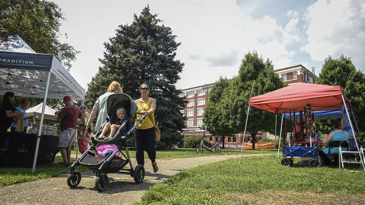 Photos by Mike Moore | The Journal Gazette Exposing children to shopping at markets such as Ft. Wayne's Farmers Market at McCulloch Park helps give kids a wider shopping perspective.