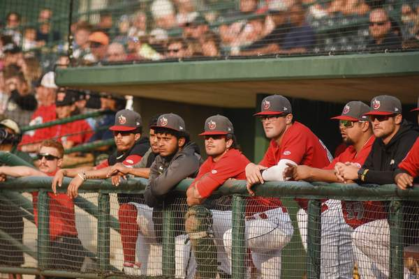 Mike Moore | The Journal Gazette The TinCaps watch the game Thursday from the dugout at Parkview Field.
