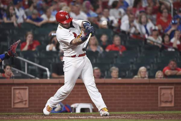 St. Louis Cardinals' Yadier Molina hits a single to drive in the winning run during the 10th inning of the team's baseball game against the Chicago Cubs on Wednesday, July 21, 2021, in St. Louis. (AP Photo/Joe Puetz)