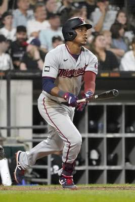 Minnesota Twins' Jorge Polanco watches his three-run home run off Chicago White Sox relief pitcher Codi Heuer during the sixth inning of a baseball game Wednesday, July 21, 2021, in Chicago. (AP Photo/Charles Rex Arbogast)
