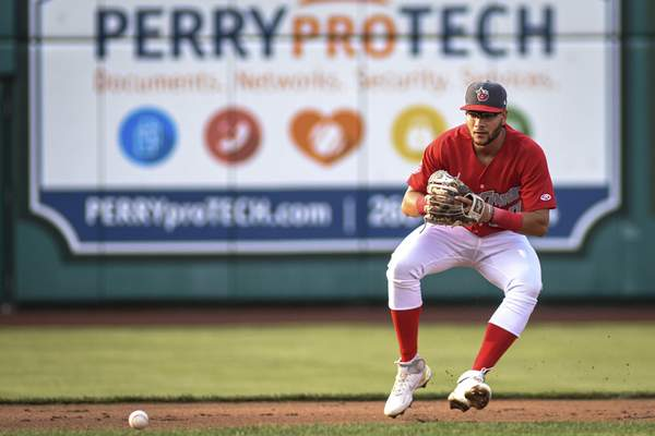 Mike Moore | The Journal Gazette TinCaps shortstop Justin Lopez scoops up a grounder in the first inning against the Dragons on Wednesday.