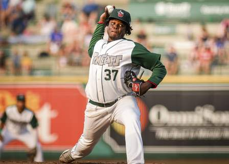 Mike Moore | The Journal Gazette TinCaps pitcher Moises Lugo winds up before the pitch in the second inning against Dayton at Parkview Field on Friday.