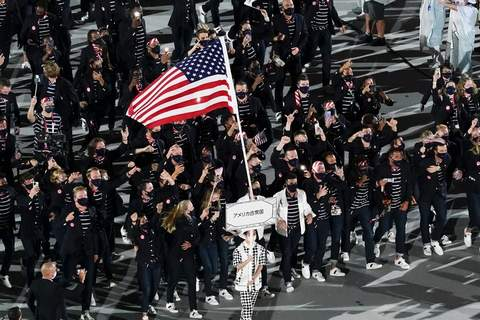 Tokyo Olympics Opening Ceremony Photo Gallery Sue Bird and Eddy Alvares, of the United States of America, carry their country's flag during the opening ceremony at the Olympic Stadium at the 2020 Summer Olympics, Friday, July 23, 2021, in Tokyo. (AP Photo/Morry Gash) (Morry Gash STF)