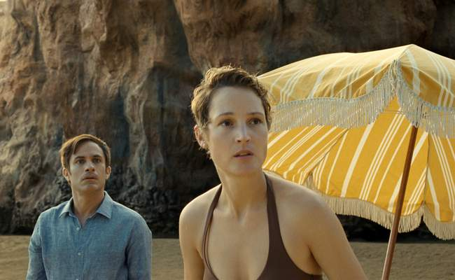 This image released by Universal Pictures shows Gael GarcÃa Bernal and Vicky Krieps in a scene from Old. (Universal Pictures via AP)