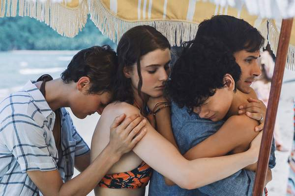 This image released by Universal Pictures shows, from left, Vicky Krieps, Thomasin McKenzie, Gael GarcÃa Bernal and Luca Faustino Rodriguez in a scene from Old. (Universal Pictures via AP)