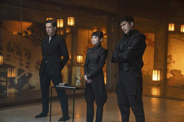 This image released by Paramount Pictures shows, from left, Andrew Koji, Haruka Abe and Henry Golding in a scene from Snake Eyes: G.I. Joe Origins. (Scott Garfield/Paramount Pictures via AP)