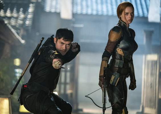 This image released by Paramount Pictures shows Henry Golding, left, and Samara Weaving in a scene from Snake Eyes: G.I. Joe Origins. (Niko Tavernise/Paramount Pictures via AP)