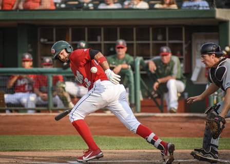 Mike Moore | The Journal Gazette TinCaps designated hitter Agustin Ruiz, left takes off after hitting a short grounder as Dayton's catcher James Free chases down the ball in first inning against at Parkview Field on Saturday.