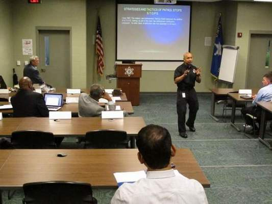 Courtesy  Capt. Juan Barrientes, director of training at the Fort Wayne Police Department, lectures a group of law enforcement officials.