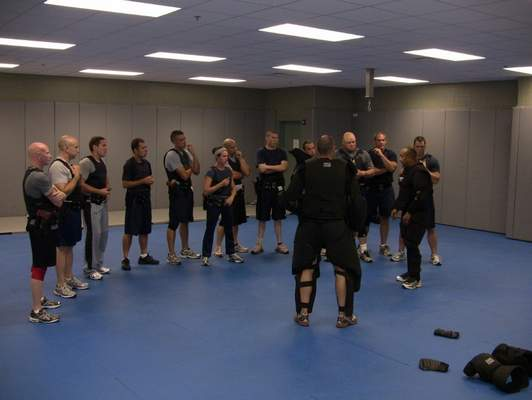 Courtesy  Capt. Juan Barrientes, director of training at the Fort Wayne Police Department, foreground right, leads a group in use of force training.