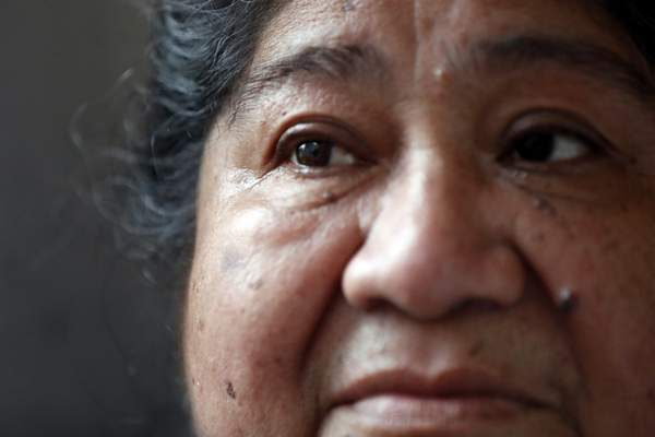 Associated Press Maria Elena Estamilla, 62, sheds tears at her house in Chicago's Pilsen neighborhood while sharing her struggle of living without health insurance.
