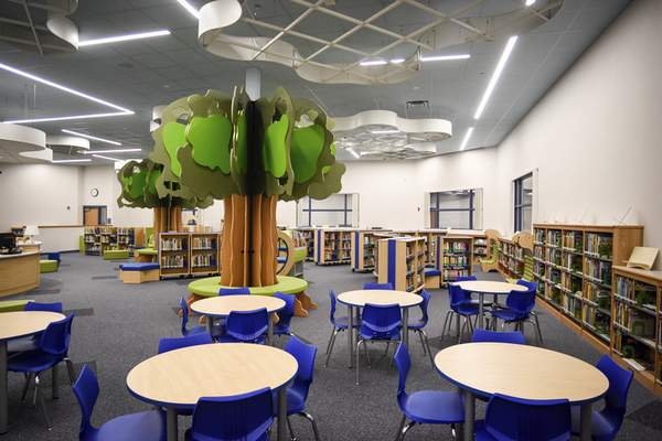 Mike Moore | The Journal Gazette The library at the new Aspen Meadow Elementary School on Hathaway Road intends to help students get lost in reading.
