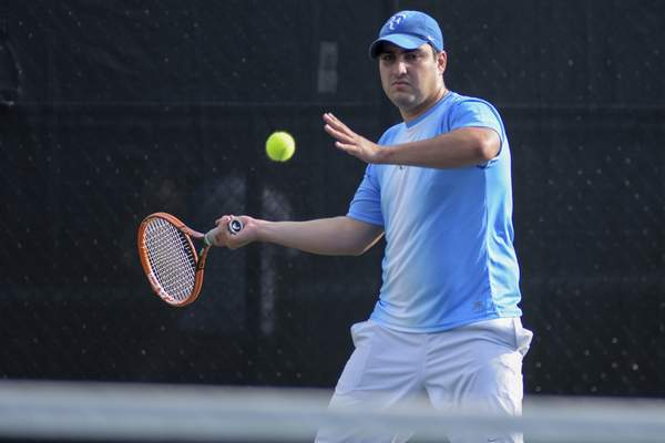 Mike Moore | The Journal Gazette Andres Cohos competes in the City Tennis Tournament Men's Open Singles final at Swinney Tennis Center on Monday.