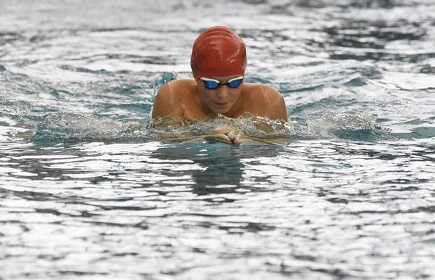 Rachel Von Stroup | The Journal Gazette A swimmer with Pine Valley Country Club races in the Boys 11-12 200 Medley Relay during the City Swim Meet at Helen P. Brown Natatorium on Sunday August 4, 2019.