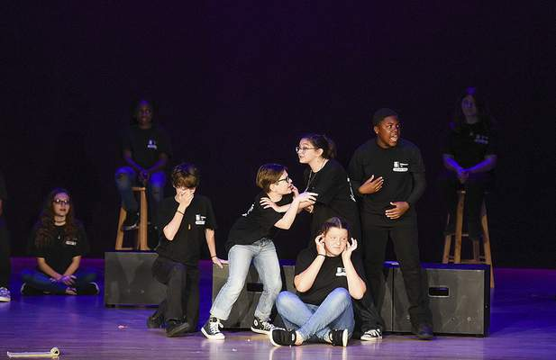 Katie Fyfe | The Journal Gazette Young actors perform on the Embassy Theatre stage Sunday as part of SCORE!, a musical theater workshop for students in grades six, seven and eight. Embassy Theatre collaborated with Fort Wayne Youtheatre this year.