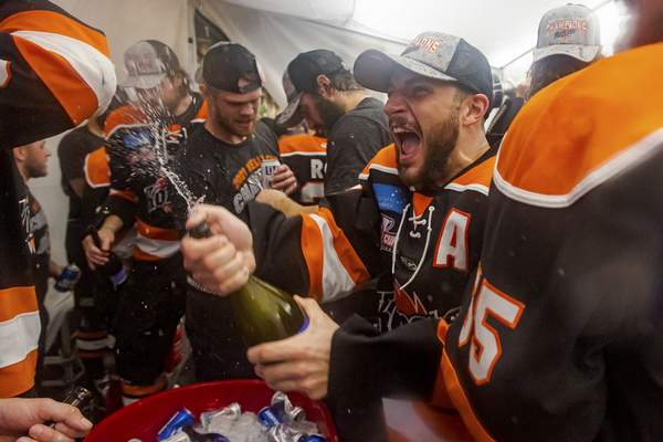 Josh Gales   Special to The Journal Gazette  The Komets' Anthony Petruzzelli sprays some champagne after the Komets won the Kelly Cup at Memorial Coliseum.