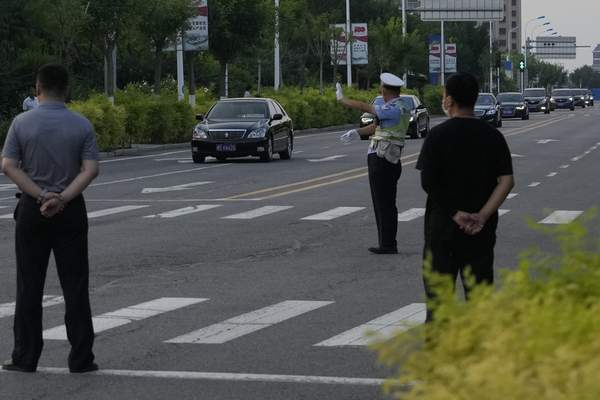A car with a sign which reads Special transport for Foreign Affairs Reception is seen ahead of a convoy of cars that is believed to include U.S. deputy secretary Wendy Sherman as they prepare to enter the Tianjin Binhai No. 1 Hotel where U.S. and Chinese officials are expected to meet in Tianjin municipality in China on Sunday, July 25, 2021. (AP Photo/Ng Han Guan)