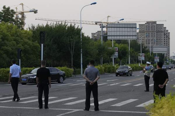 A car with a sign which reads Special transport for Foreign Affairs Reception, center is seen ahead of a convoy of cars that is believed to include U.S. deputy secretary Wendy Sherman as they prepare to enter the Tianjin Binhai No. 1 Hotel where U.S. and Chinese officials are expected to meet in Tianjin municipality in China on Sunday, July 25, 2021. (AP Photo/Ng Han Guan)