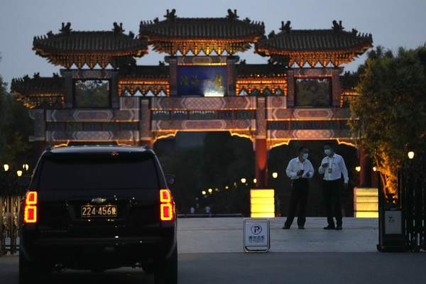 A U.S. embassy car waits outside the Tianjin Binhai No. 1 Hotel where U.S. and Chinese officials are expected to hold talks in Tianjin municipality in China on Sunday, July 25, 2021. (AP Photo/Ng Han Guan)
