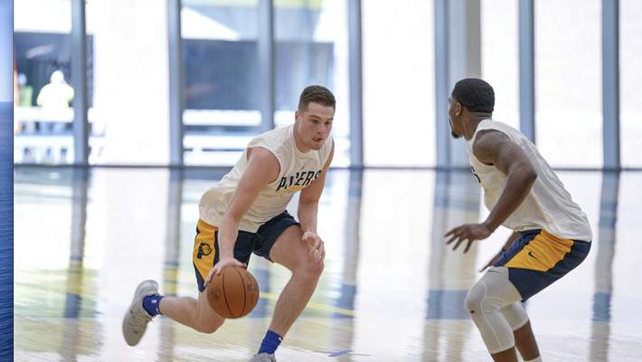 Courtesy Pacers Sports & Entertainment Warsaw native and former Indiana Wesleyan star Kyle Mangas drives at North Side product Trevion Crews during a pre-draft workout Monday in Indianapolis for the Indiana Pacers. The NBA draft is Thursday.