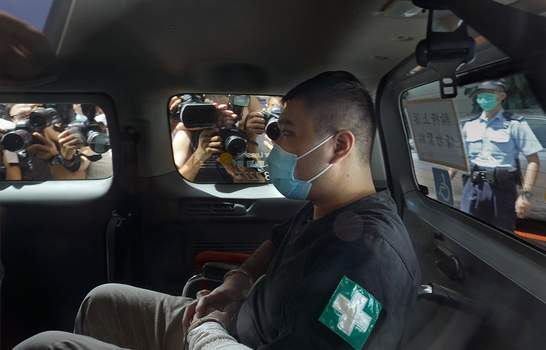 Hong Kong FILE - In this July 6, 2020, file photo, Tong Ying-kit arrives at a court in a police van in Hong Kong. (AP Photo/Vincent Yu, File) (Vincent Yu STF)