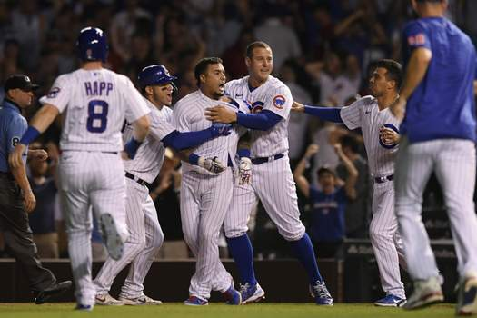 Reds Cubs Baseball Chicago Cubs' Javier Baez center, celebrates with teammates after hitting a walk-off single in the ninth inning to defeat the Cincinnati Reds 6-5 in a baseball game Monday, July 26, 2021, in Chicago. (AP Photo/Paul Beaty) (Paul Beaty FRE)