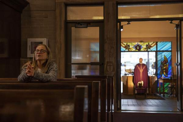 Associated Press Fran DiBiasio sits alone in Our Lady of Grace Catholic Church in Johnston, R.I. A drop in religious affiliation is one factor in a decline in charitable giving from U.S. households.