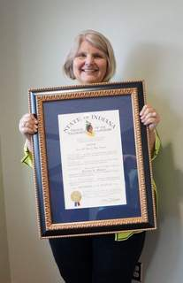 Photo courtesy of Ivy Tech Community College Fort Wayne. Jerrilee Mosier poses with the Sagamore of the Wabash award given to her Tuesday in recognition of her work as chancellor of Ivy Tech Community College Fort Wayne.
