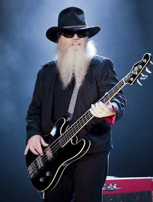FILE - Bassist and vocalist Dusty Hill, from the US rock band, ZZ Top performs at the F1 Rocks concert on Sept. 25, 2009, in Singapore. (AP Photo/Joan Leong, File)