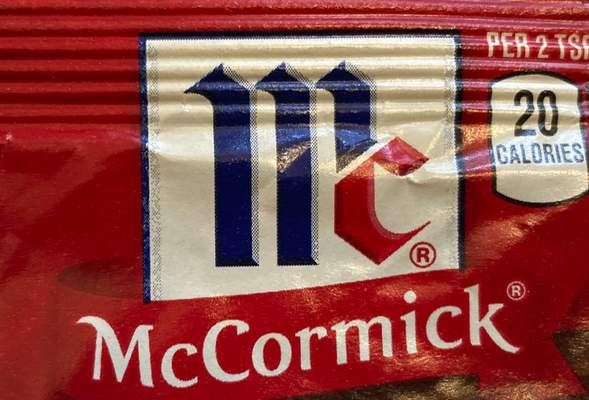 FILE - This Tuesday Nov. 24, 2020, file photo shows the logo for McCormick & Co. McCormick is voluntarily recalling some seasonings due to possible salmonella contamination. The company said this week that it's recalling McCormick Perfect Pinch Italian Seasoning, McCormick Culinary Italian Seasoning and Frank's RedHot Buffalo Ranch Seasoning. (AP Photo/Donald King, FIle)