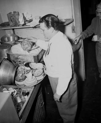 Don Machon of Machon's Restaurant, 202 W. Berry St., looks at piles of dishes that need to be washed. He planned to buy a supply of paper plates the next morning.