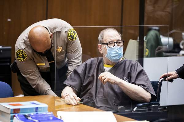 Harvey Weinstein, the 69-year-old convicted rapist and disgraced movie mogul, wears a face mask behind a protective plexiglass screen, as he listens in court during a pre-trial hearing in Los Angeles, Thursday, 29 July 2021. (Etienne Laurent/Pool Photo via AP)