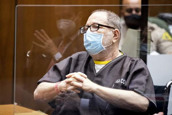 Harvey Weinstein, the 69-year-old convicted rapist and disgraced movie mogul, wears a face mask as he listens in court during a pre-trial hearing in Los Angeles, Thursday, 29 July 2021. (Etienne Laurent/Pool Photo via AP)