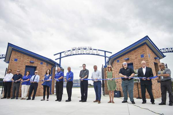 Katie Fyfe   The Journal Gazette  A ribbon cutting ceremony is held to celebrate the overhaul of the stadium, marching band practice fields, soccer fields, track, football field, surrounding grounds, out buildings and parking lots at Carroll High School on Thursday.