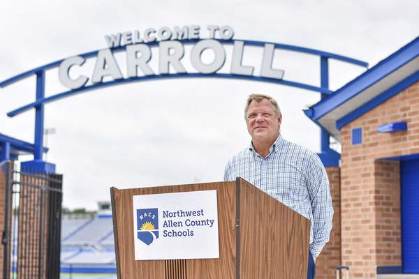 Katie Fyfe   The Journal Gazette  CEO of Weigand Construction Larry Weigand speaks during the ribbon cutting to celebrate the overhaul of the stadium, marching band practice fields, soccer fields, track, football field, surrounding grounds, out buildings and parking lots at Carroll High School on Thursday.