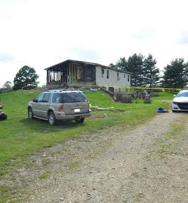 Courtesy Steuben County Sheriff's Office  A person of interest was named in the death of a man who had been reported missing. He was found in the garage of a home that had burned, though the sheriff's office reported the fire was not the cause of his death.